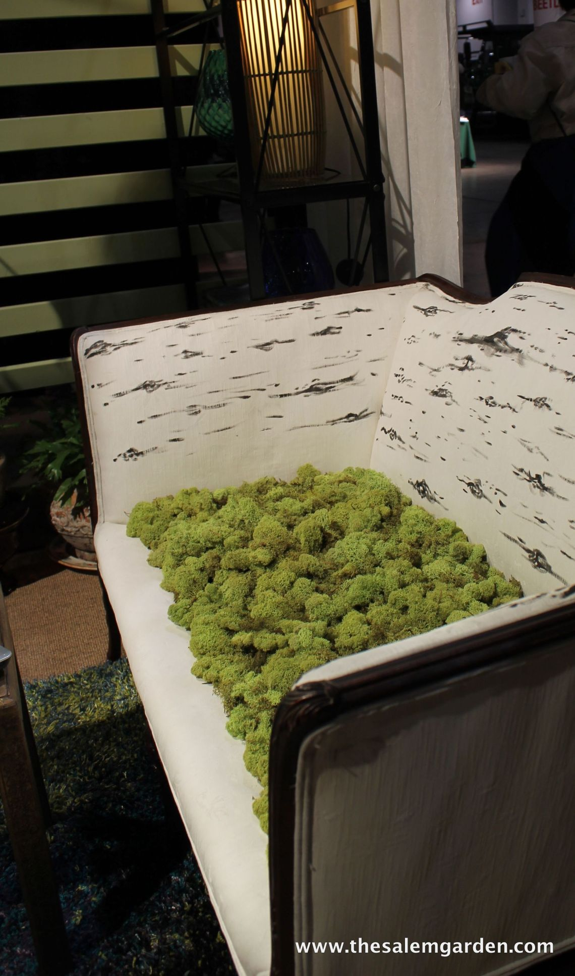 I love this settee! Who wouldn't want to sit upon a bed of moss?