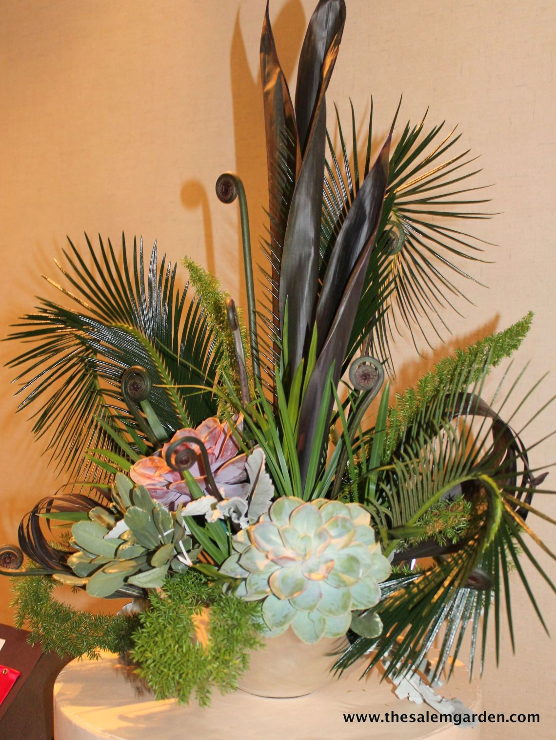 I love this use of succulents and ferns, an uncommon combination.